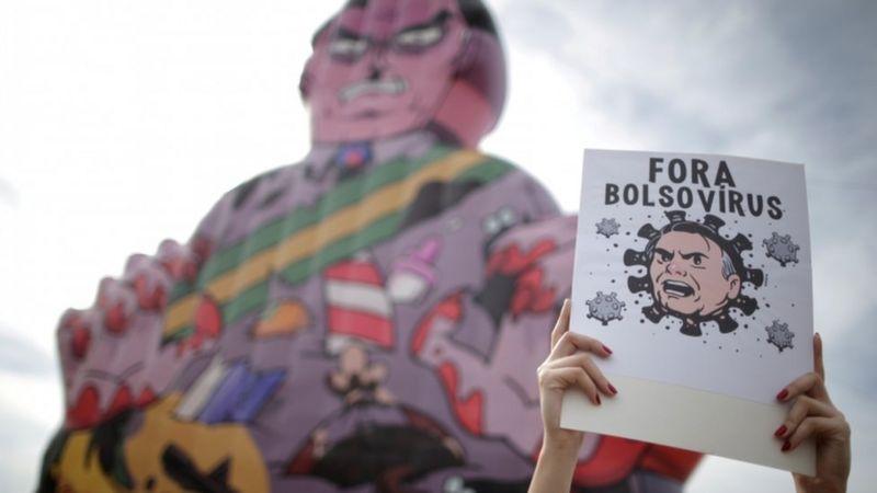 """Queremos ser VACINADOS: Como a imprensa internacional cobriu os protestos por """"impeachment"""" de Bolsonaro"""